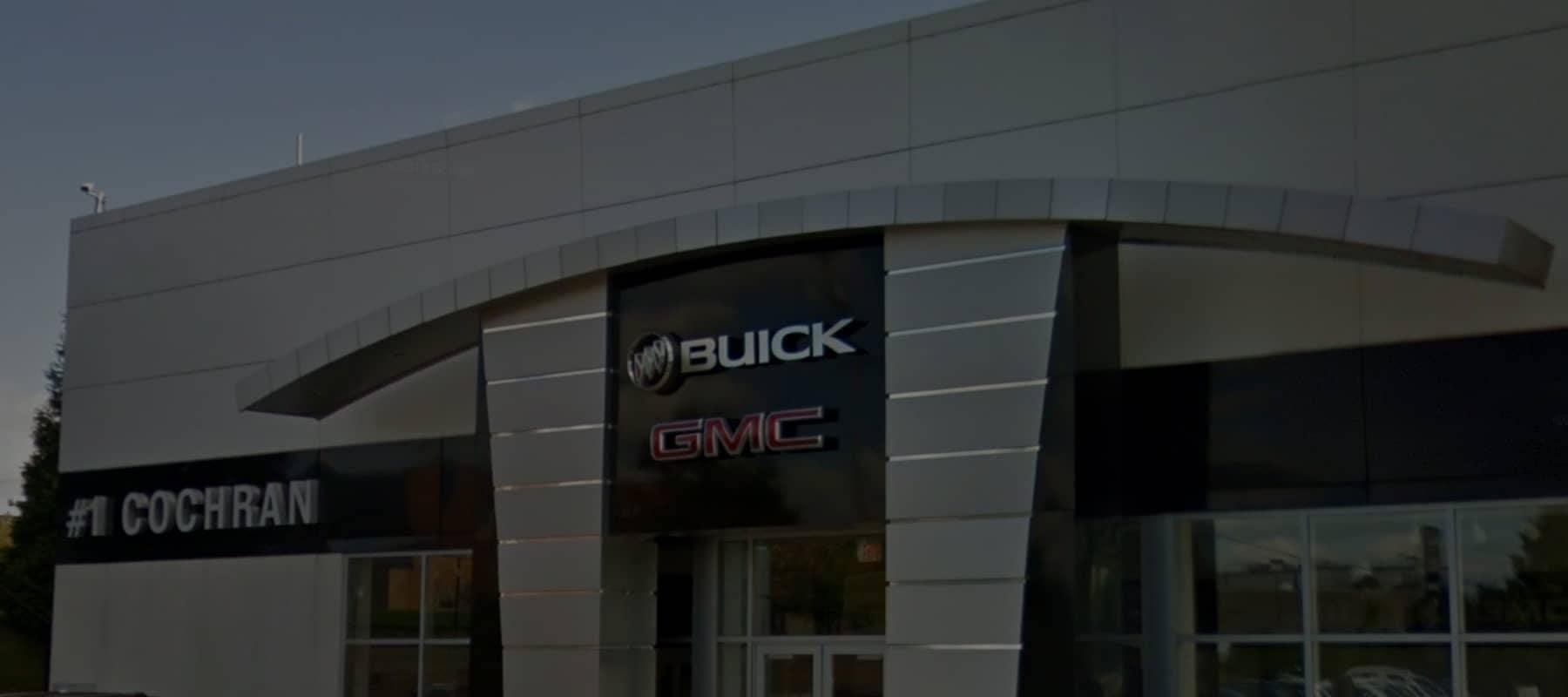 An exterior shot of a Buick/GMC dealership building
