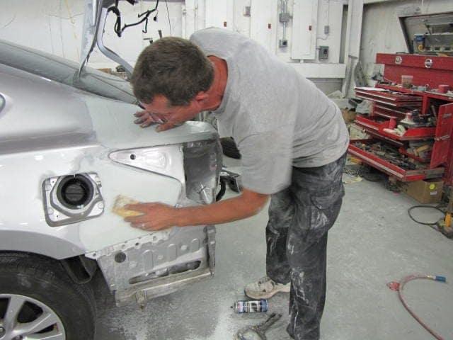 Man Working On Car Sanding