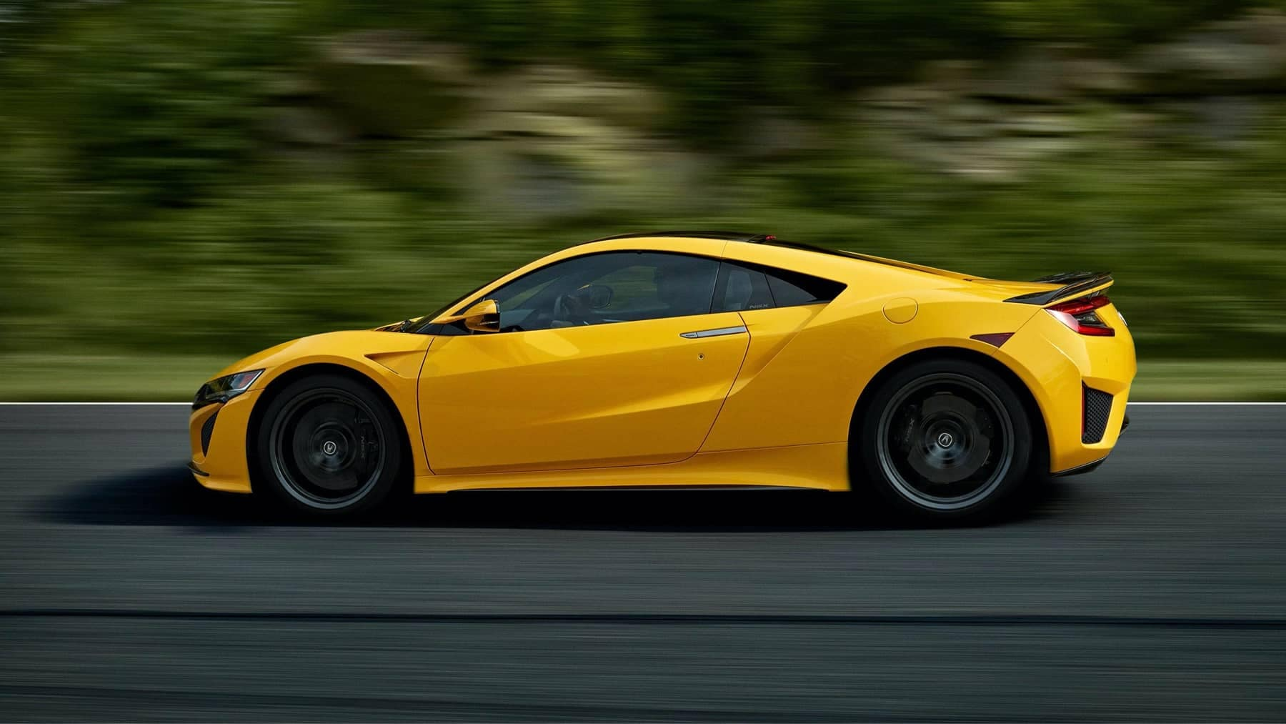 Acura-NSX-Indy-Yellow-Pearl-on-a-highway
