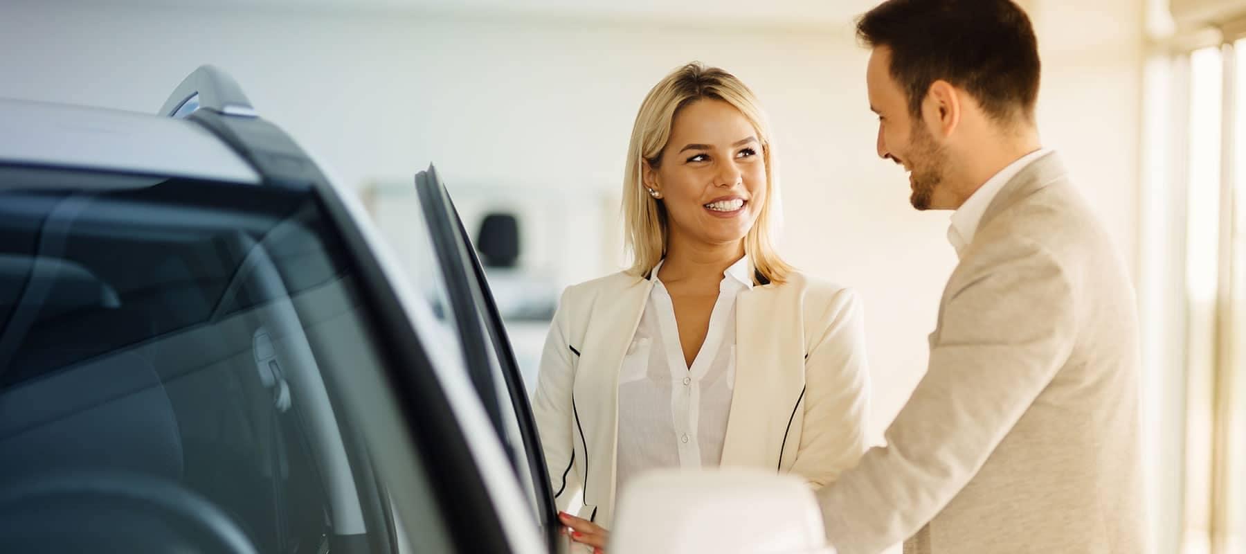 woman buying car from car salesman
