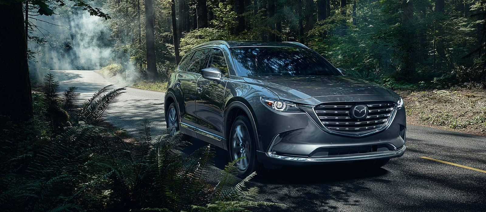 2021 Mazda CX-9 driving in the woods_mobile