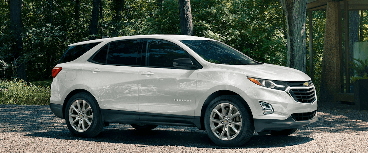 2020 Chevy Equinox white parked in forest