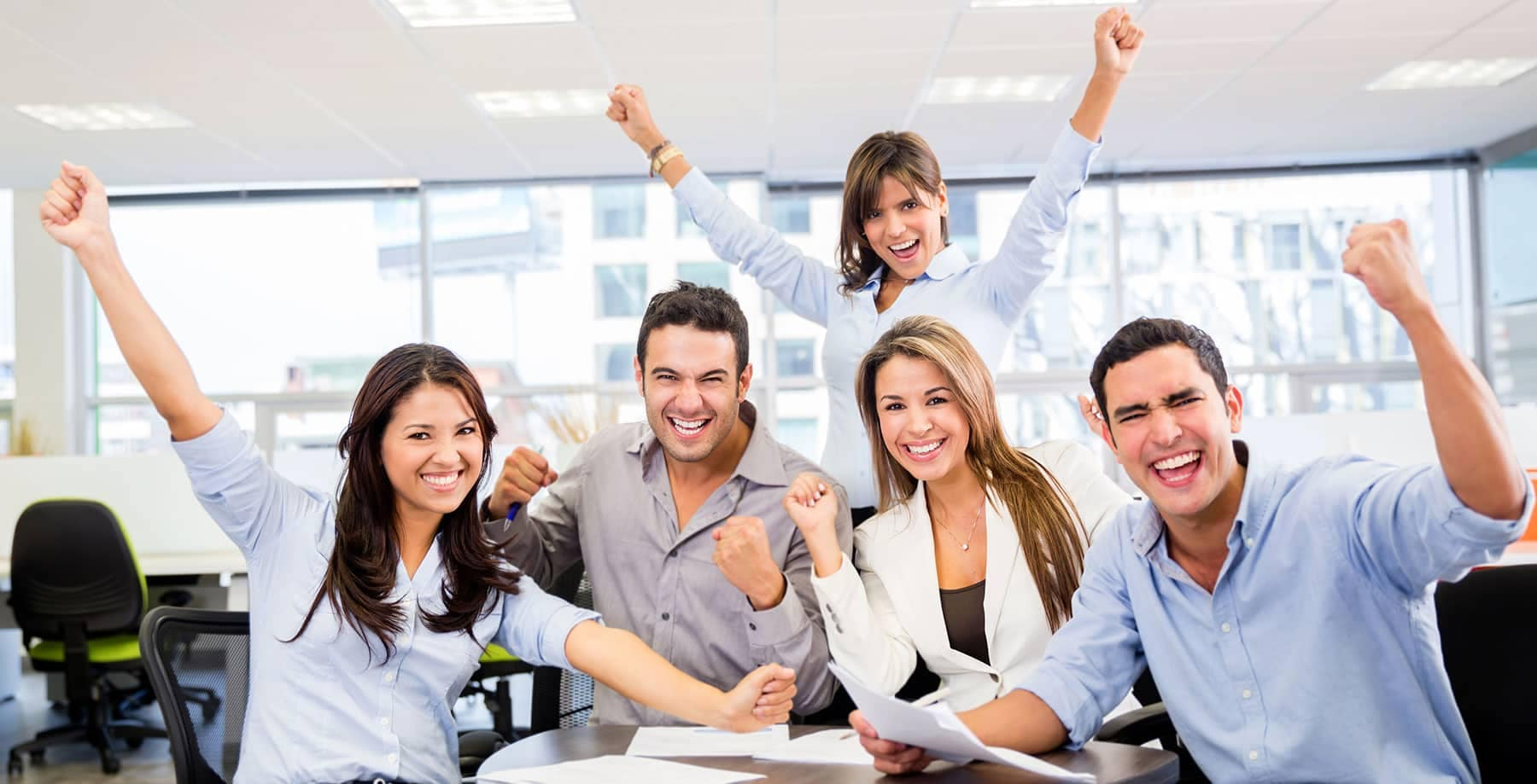 office workers raising hands for joy