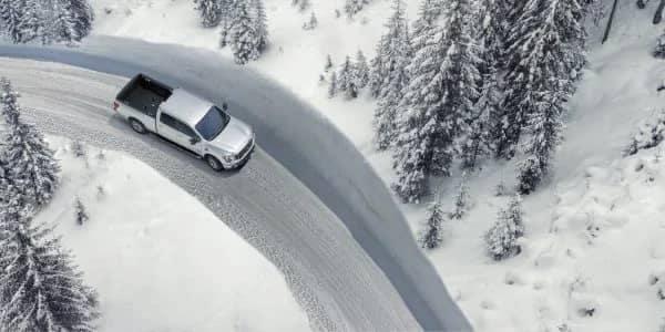 Titan driving on snowy road