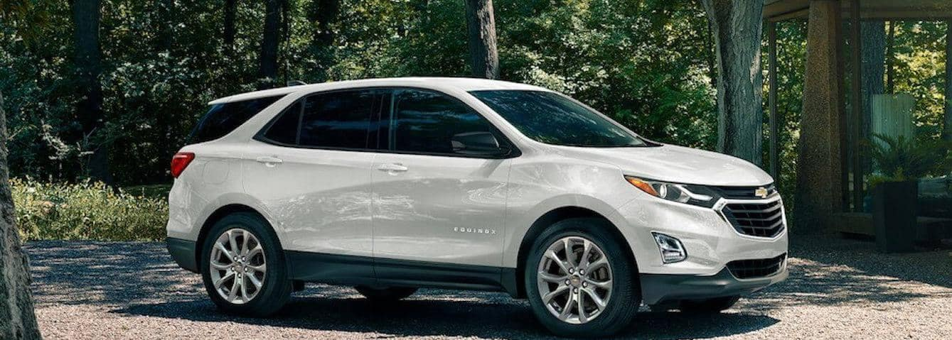 2020 White Chevrolet Equinox parked on gravel driveway in woods