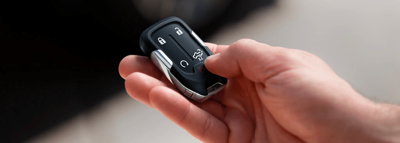 Person holding chevy key fob