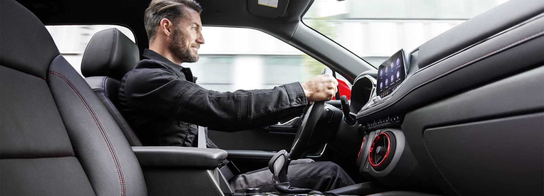 Man in Drivers Seat of 2020 Chevrolet Blazer Jet Black Leather Interior