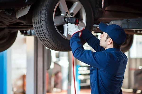 Mechanic Working on a Vehicle Tire
