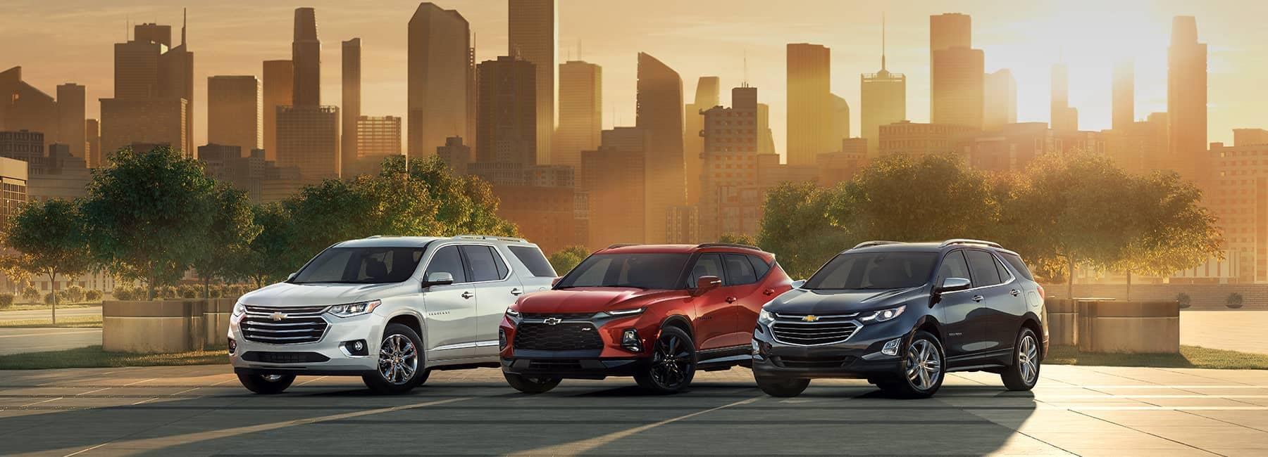 2020 Chevrolet Lineup Against a City Skyline at Sunset