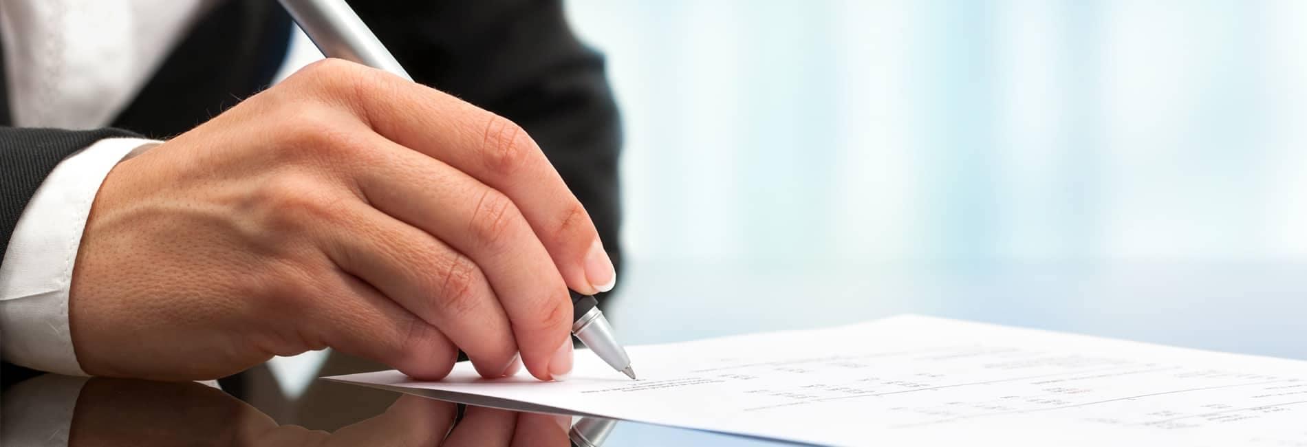 Man signs finance document