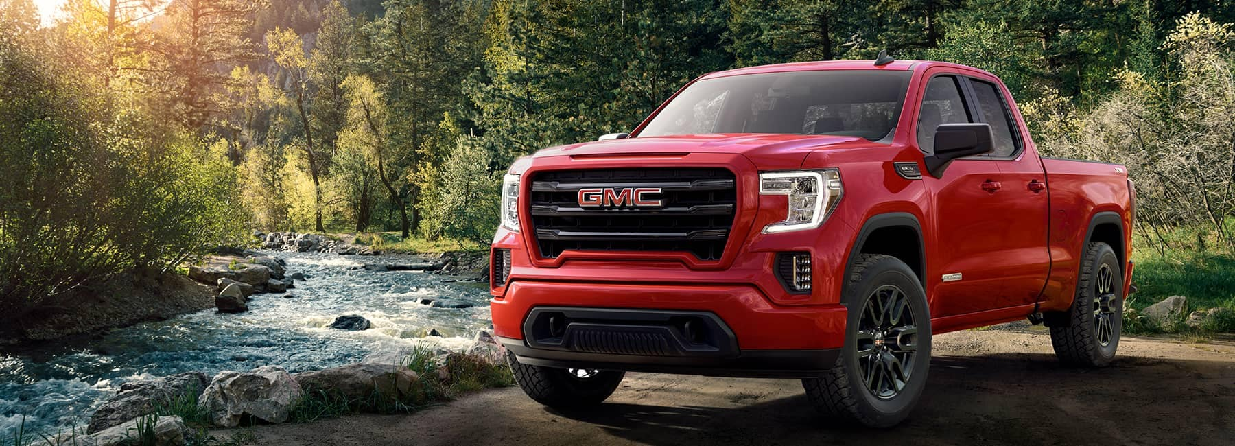 Red 2020 GMC Sierra 1500 by a River