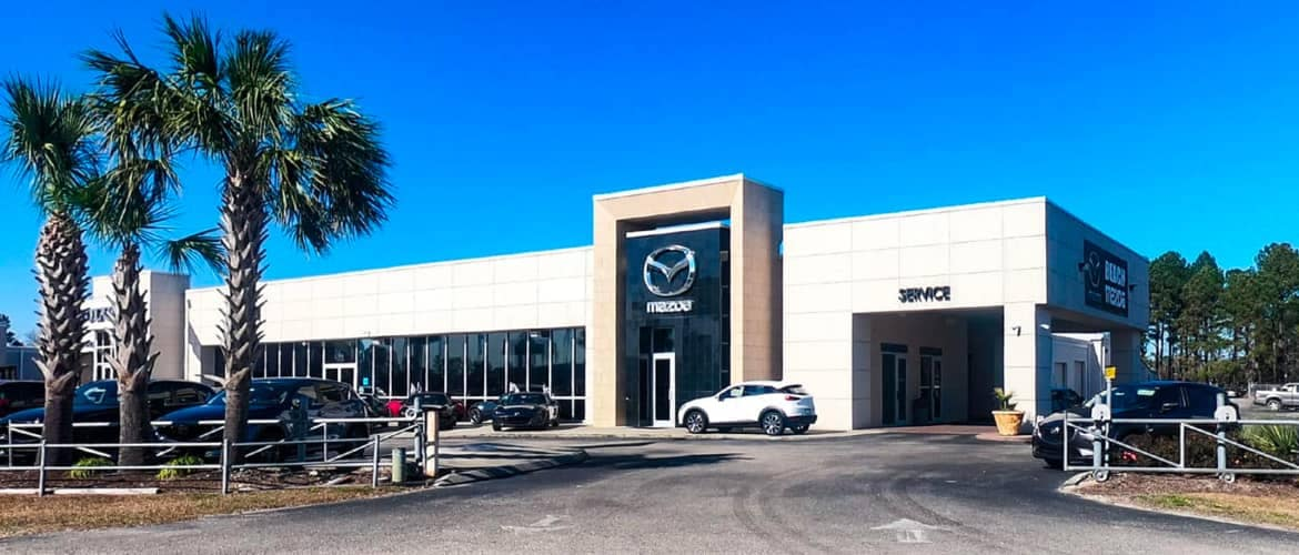 Mazda dealership outside during the day