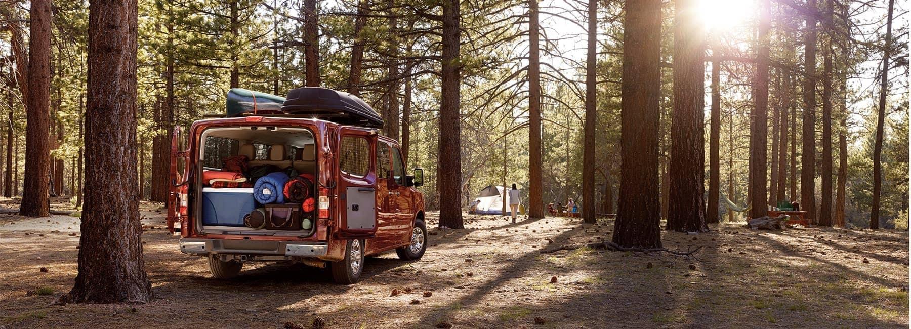 2020-nissan-nv-passenger--exterior-parked-forest