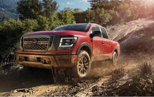 red nissan titan in mud