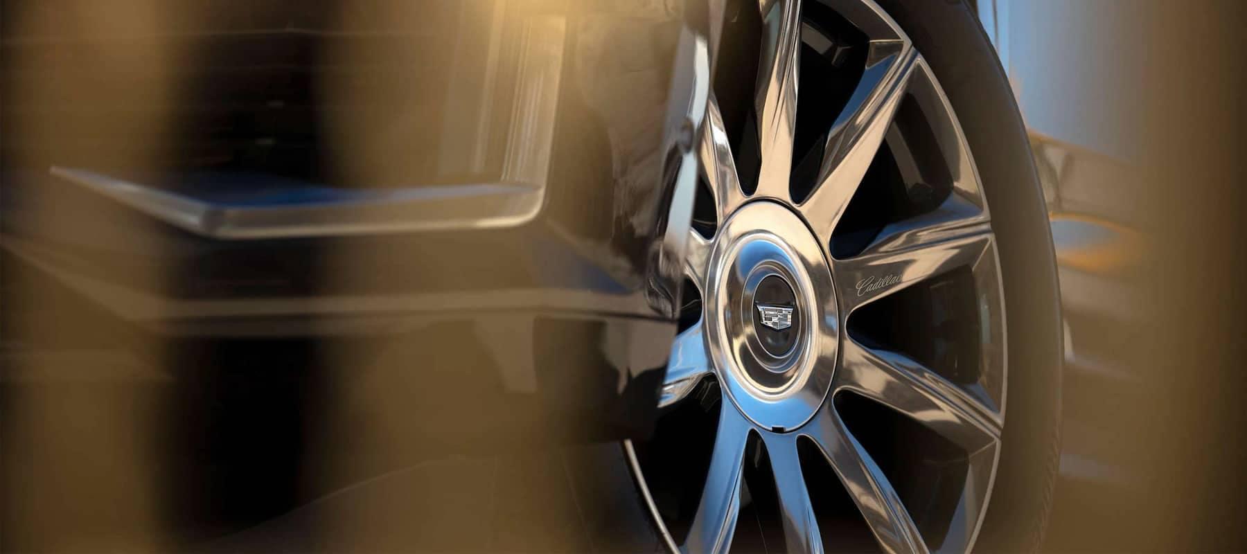 Close up view of Cadillac wheel and rim