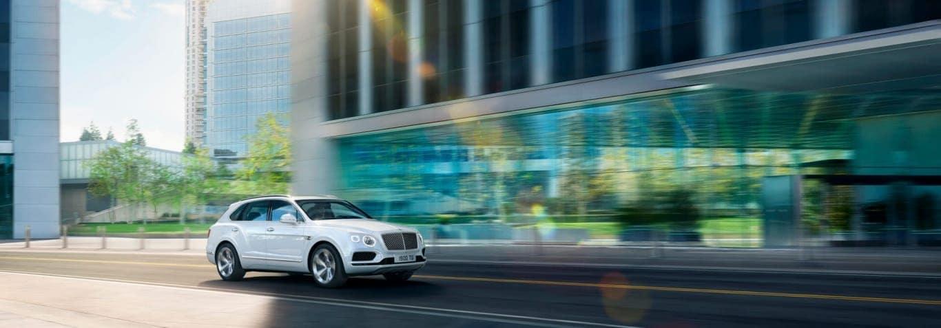 The Bentayga Hybrid driving through a city