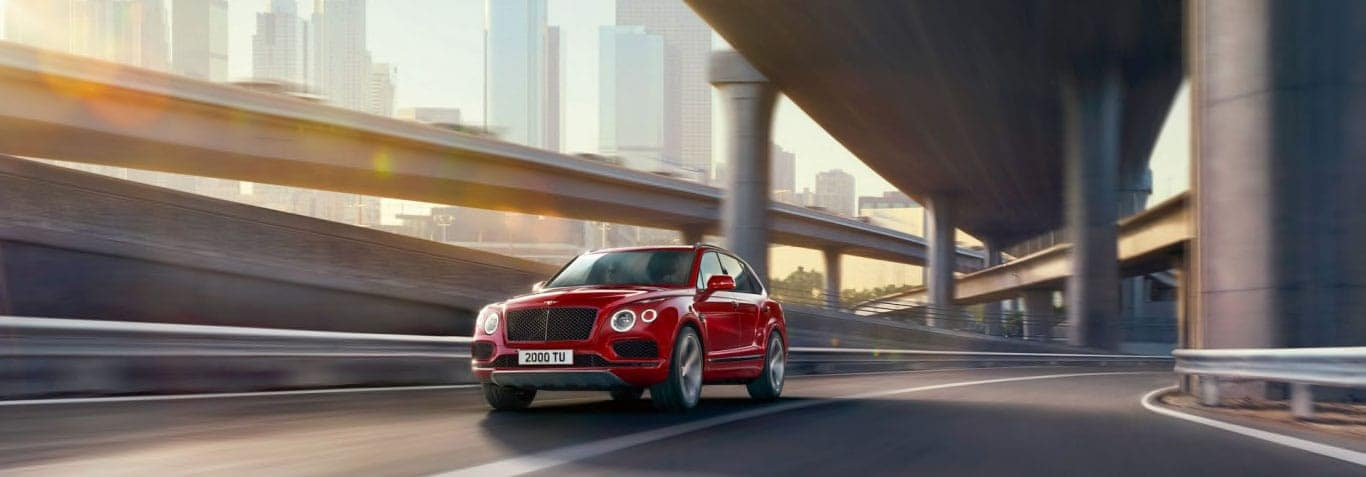 Front view of the Bentayga V8 driving down a road