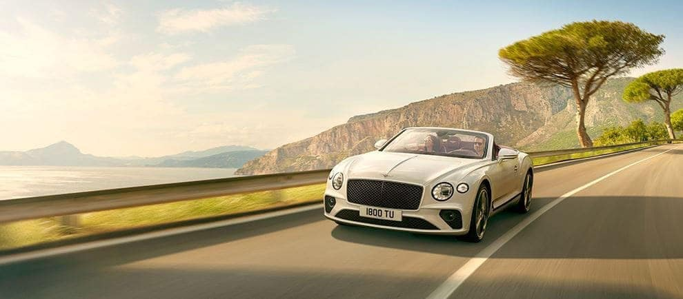 Front view of the Continental GT Convertible driving down a road