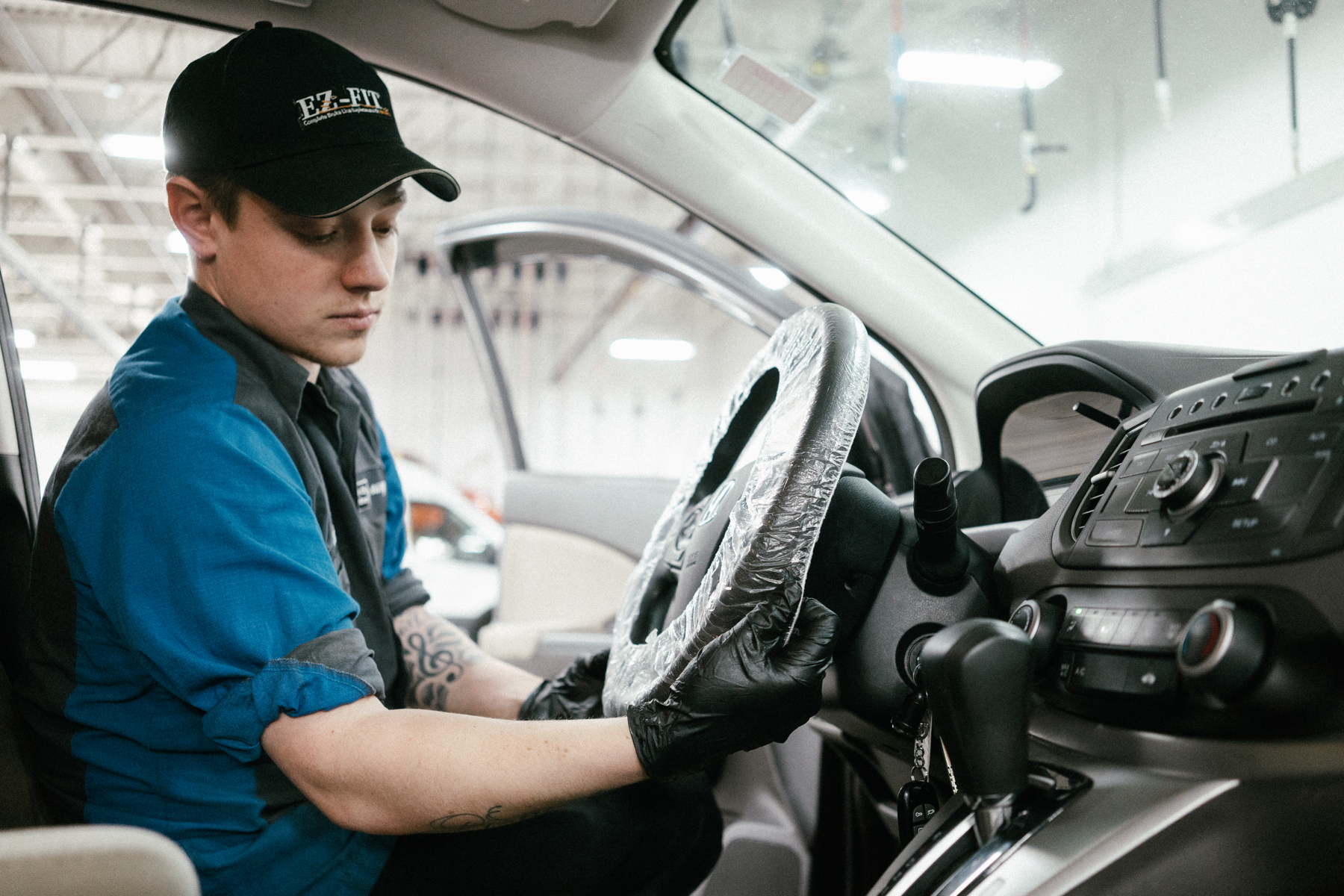 technician adds cover to steering wheel