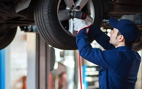 mechanic removes tire
