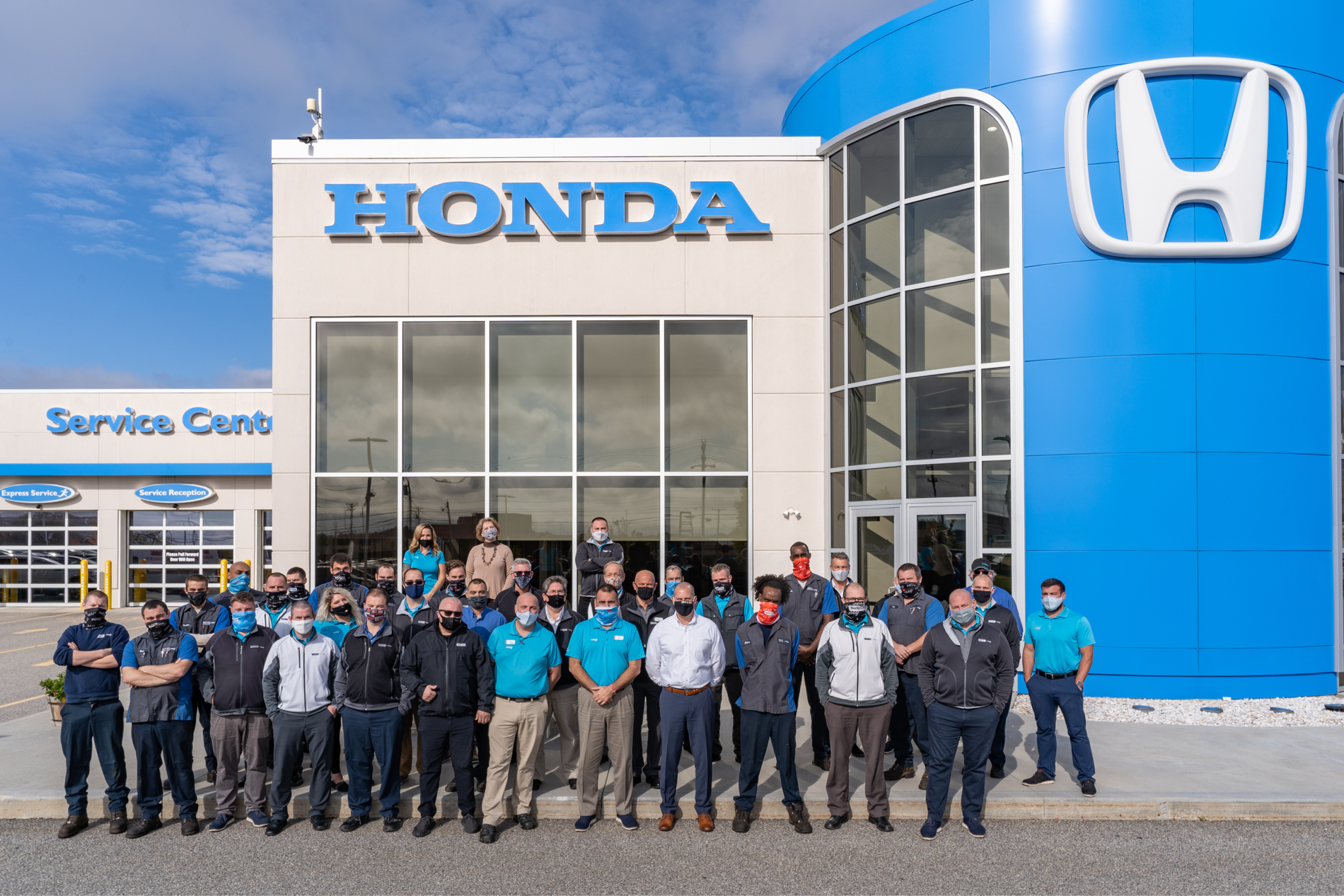 staff gathered in front of dealership