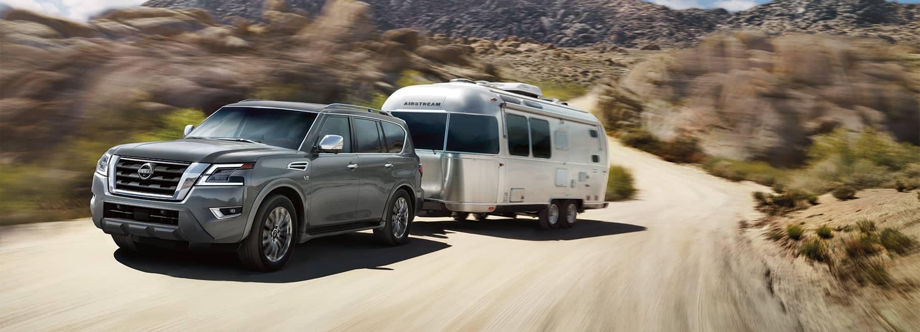 A 2021 Grey Nissan Armada hauling an Airstreem camper_mobile