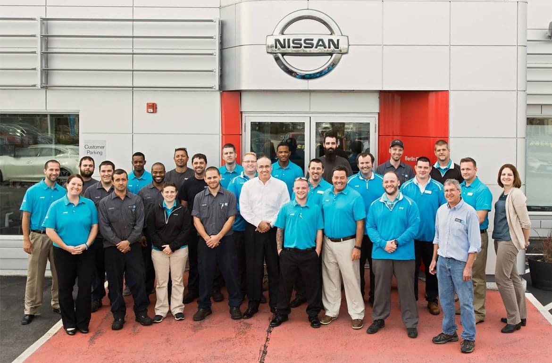 staff at Berlin City Nissan of Portland standing outside dealership entrance