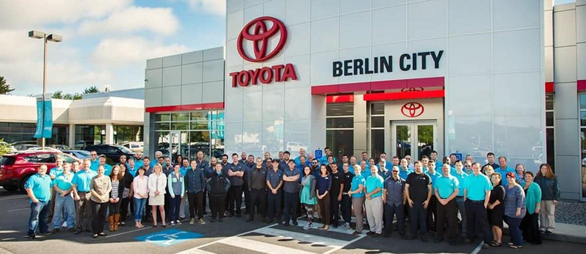 Berlin City Toyota staff stand in front of dealership entrance