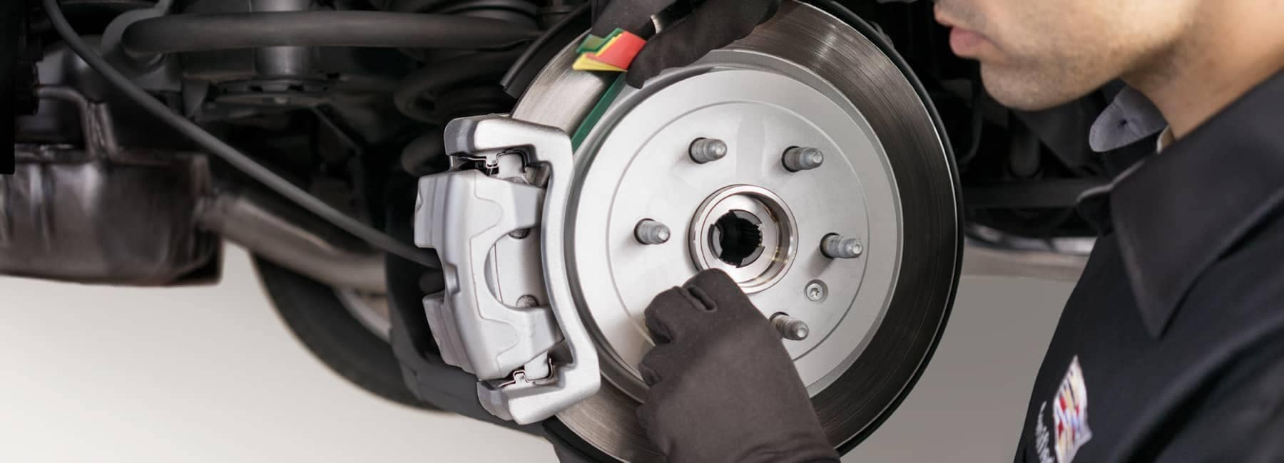 Cadillac service technician replaces rotors and brakes
