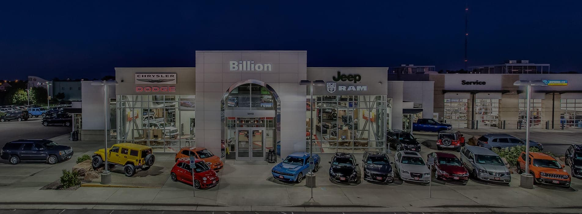 The front of the Billion Chrysler Jeep Dodge Ram FIAT dealership at night