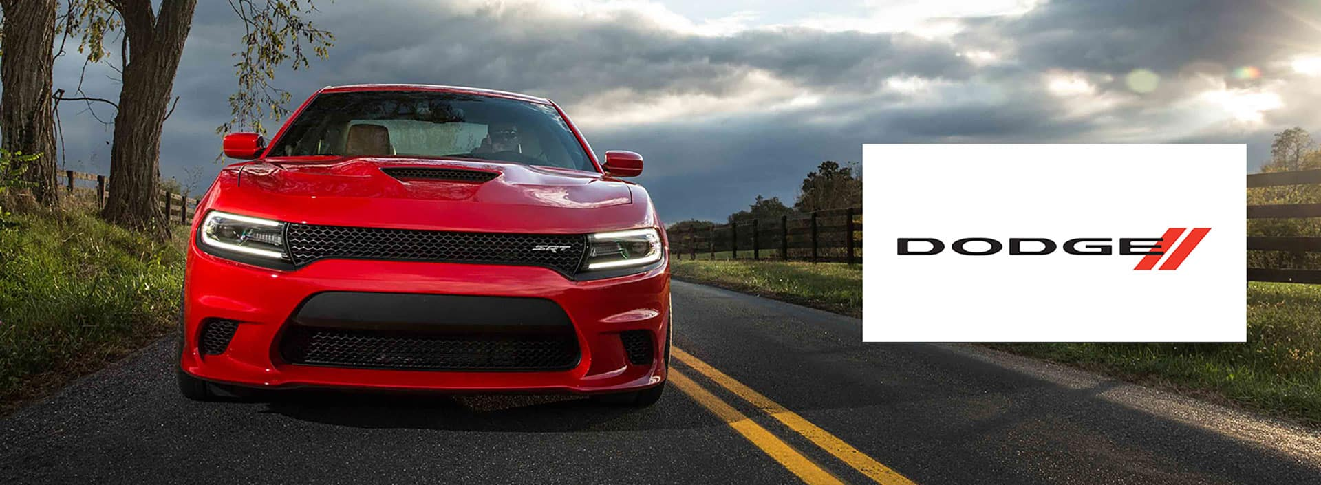 Front view of the Dodge Charger driving down a long road.