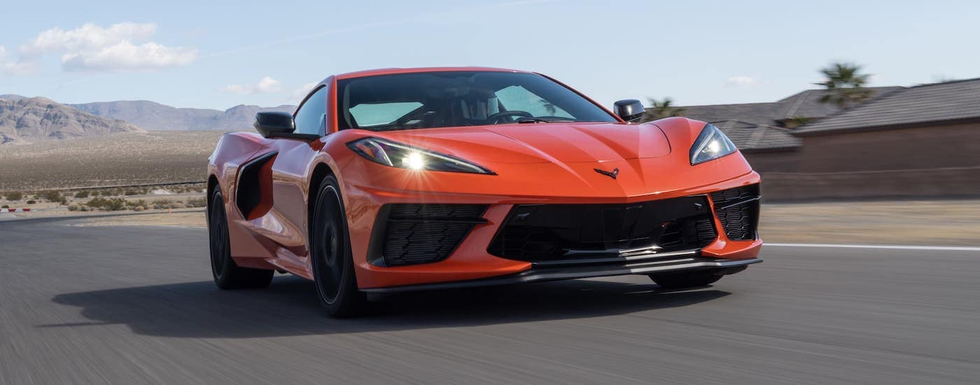A red 2020 Chevy Corvette Stingray is racing on a track.