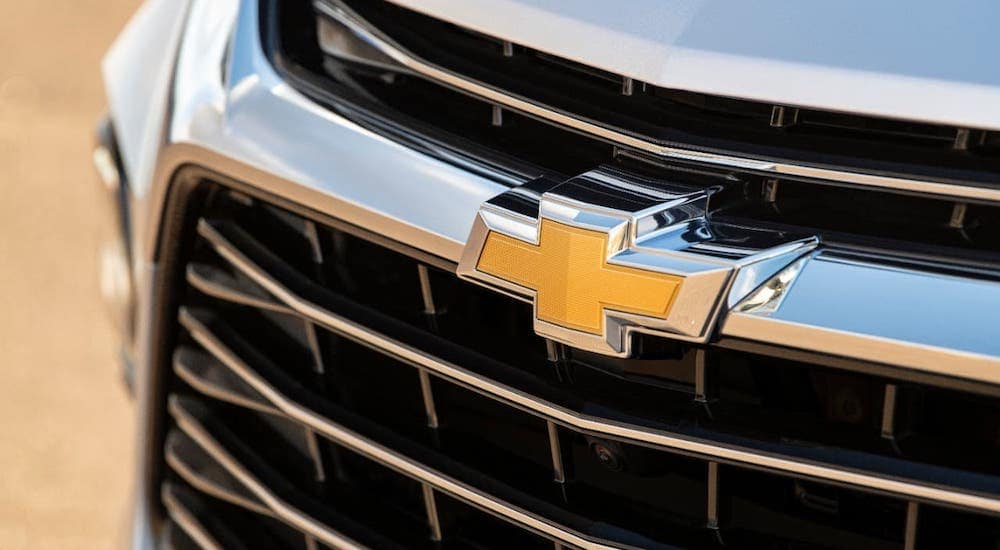 A closeup is shown of the yellow Chevrolet logo on a silver 2020 Chevy Blazer at a Chevy dealer near me in Indianapolis, IN.