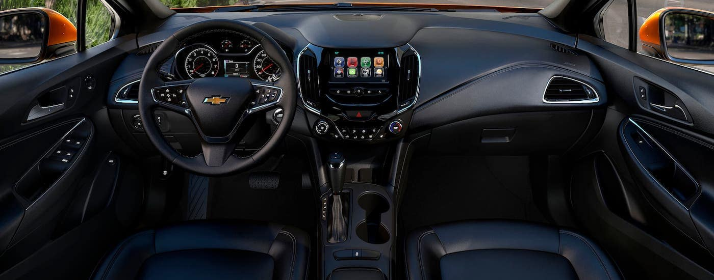 The black interior of a 2018 Chevrolet Cruze is shown in Indianapolis, IN.