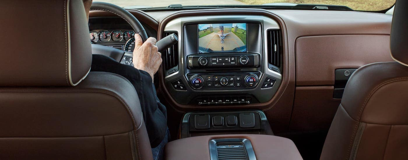 The brown leather interior is shown of a 2018 Chevrolet Silverado 1500 High Country.