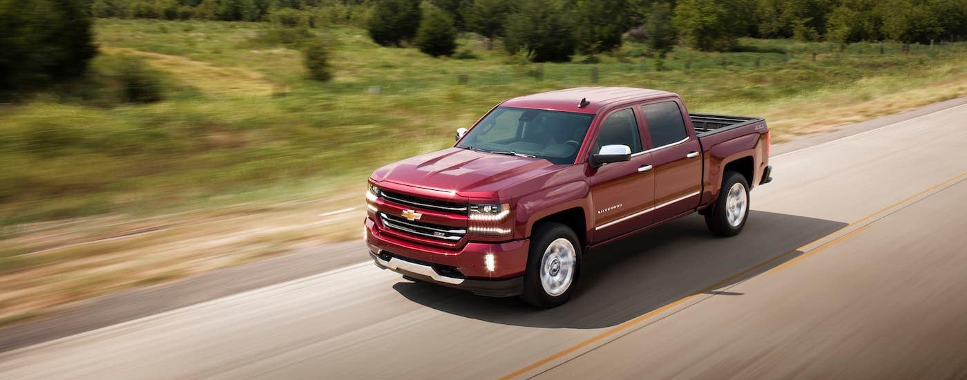 A red 2018 Chevrolet Silverado 1500 LTZ Z71 is shown from above driving on an Indianapolis highway.