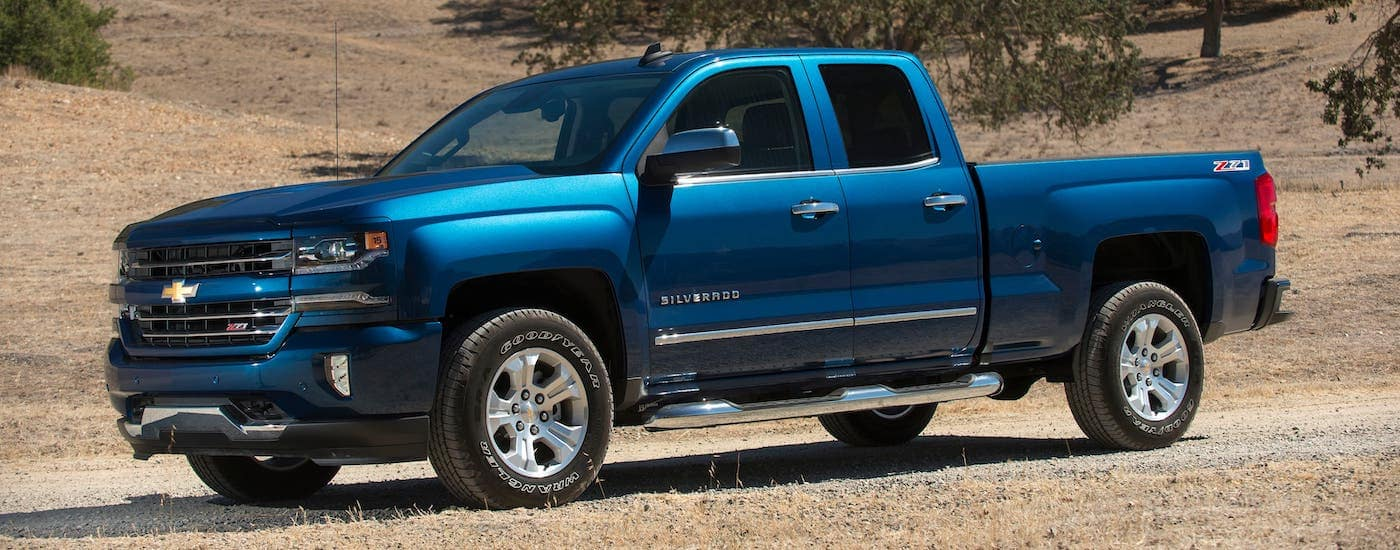 A blue 2018 Chevy Silverado is parked in a field outside Indianapolis, IN.