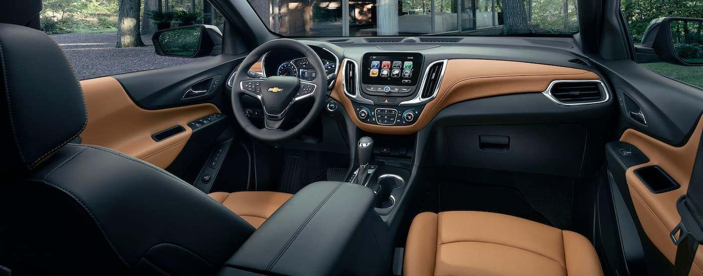 The brown and black interior of a 2019 Chevrolet Equinox is shown.