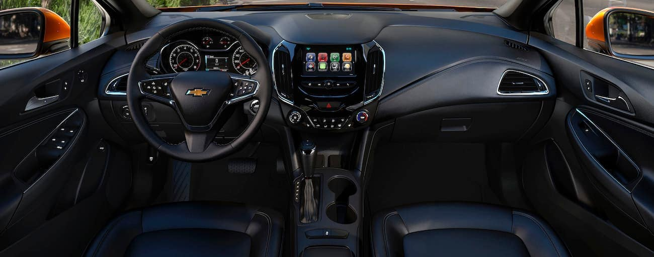The black interior of a 2019 Chevy Cruze is shown.