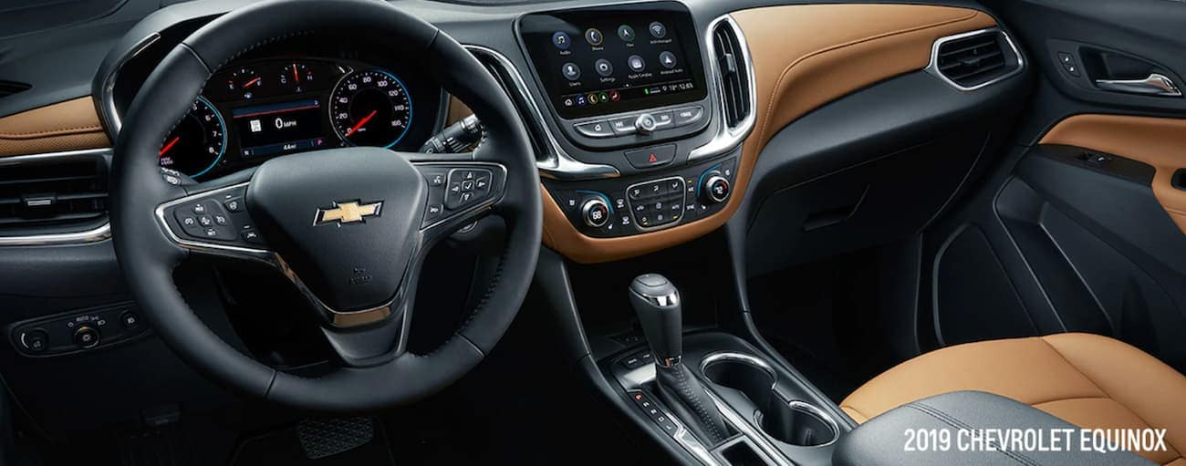 The black and tan interior of a 2019 Chevy Equinox is shown.