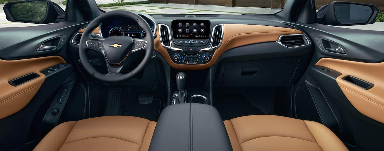 The black and tan dashboard and infotainment features are shown in a 2019 Chevy Equinox.