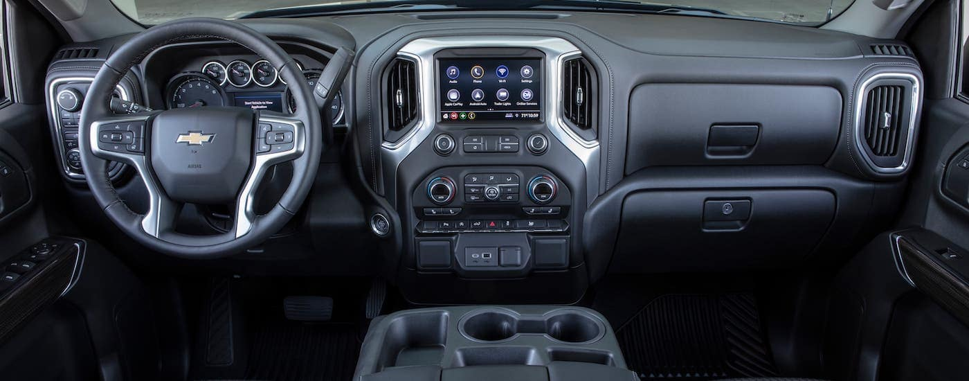 The dashboard and front interior of a 2019 Chevy Silverado is shown.