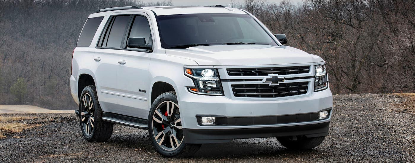 A white 2019 Chevy Tahoe RST with all the key features is parked on a gravel road in Indianapolis, IN.