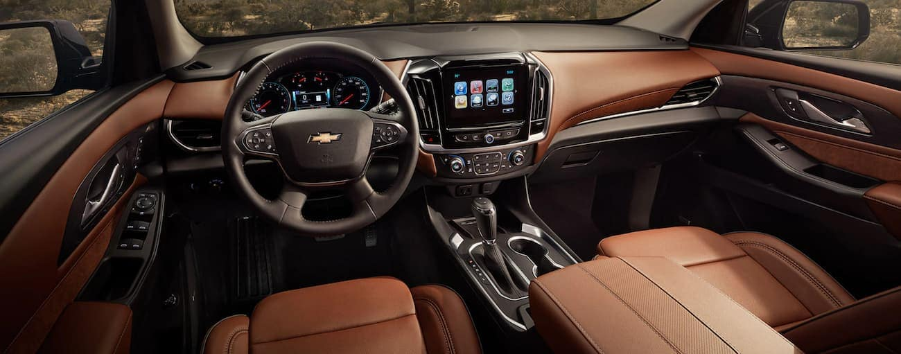 The black and tan interior of a 2019 Chevy Traverse is shown.
