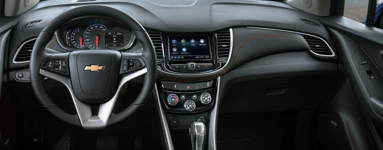 The dashboard and infotainment screen on a 2019 Chevy Trax are shown.