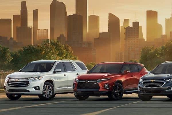 2020 Chevrolet Lineup Against a City Skyline at Sunset_mobile