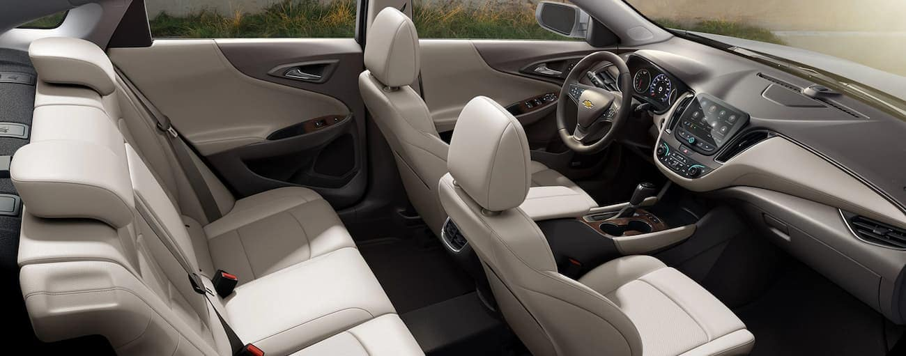 The grey and white interior of the 2020 Chevy Malibu is shown.