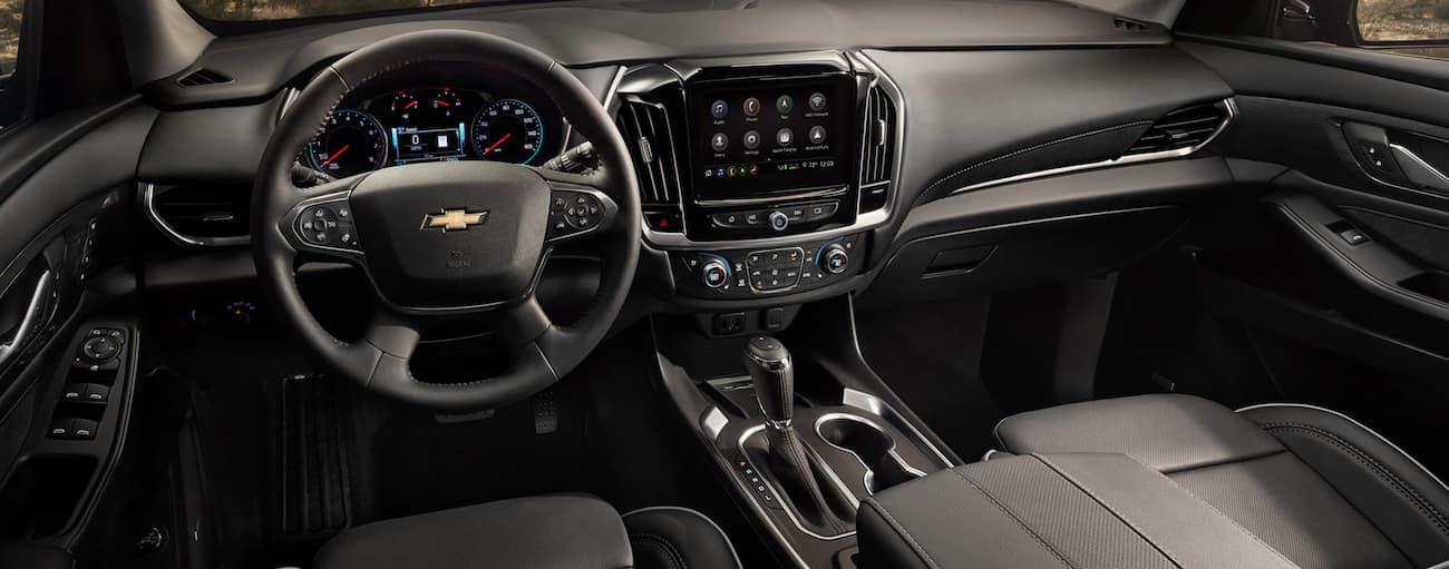 The black dashboard and infotainment screen in a 2020 Chevy Traverse are shown.