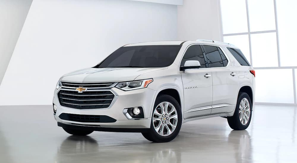 A white 2020 Chevy Traverse is parked in a bright showroom at an Anderson Chevrolet dealer.