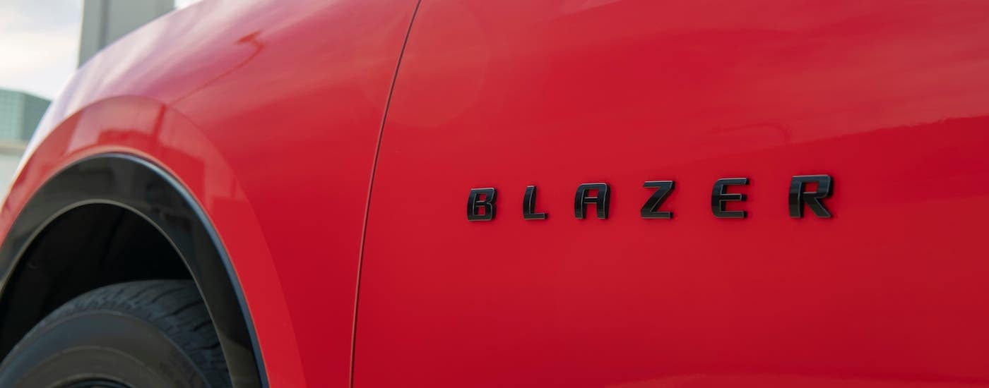 A closeup is shown of the badging on a red 2019 Chevrolet Blazer in Indianapolis, IN.